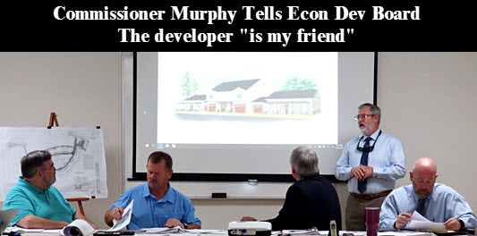 Developer Tim Williams (standing) makes his presentation. Seated: (left to right) Asst. Cnty Manager David Kraus, Chairman Murphy, Econ Dev Dir Glenn Hunter, Cnty Attorney Joel Foreman.