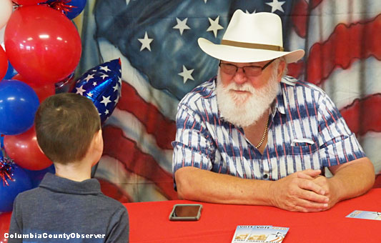 Charlie Keith speaks with a future voter.