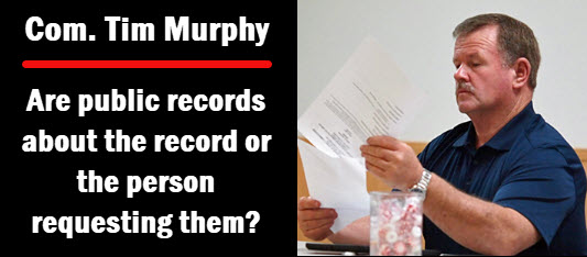 Photo of Commissioner Tim Murphy with copy: are  public records about the record or the person requesting them?