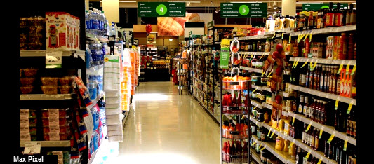 supermarket isle with fully stocked shelves